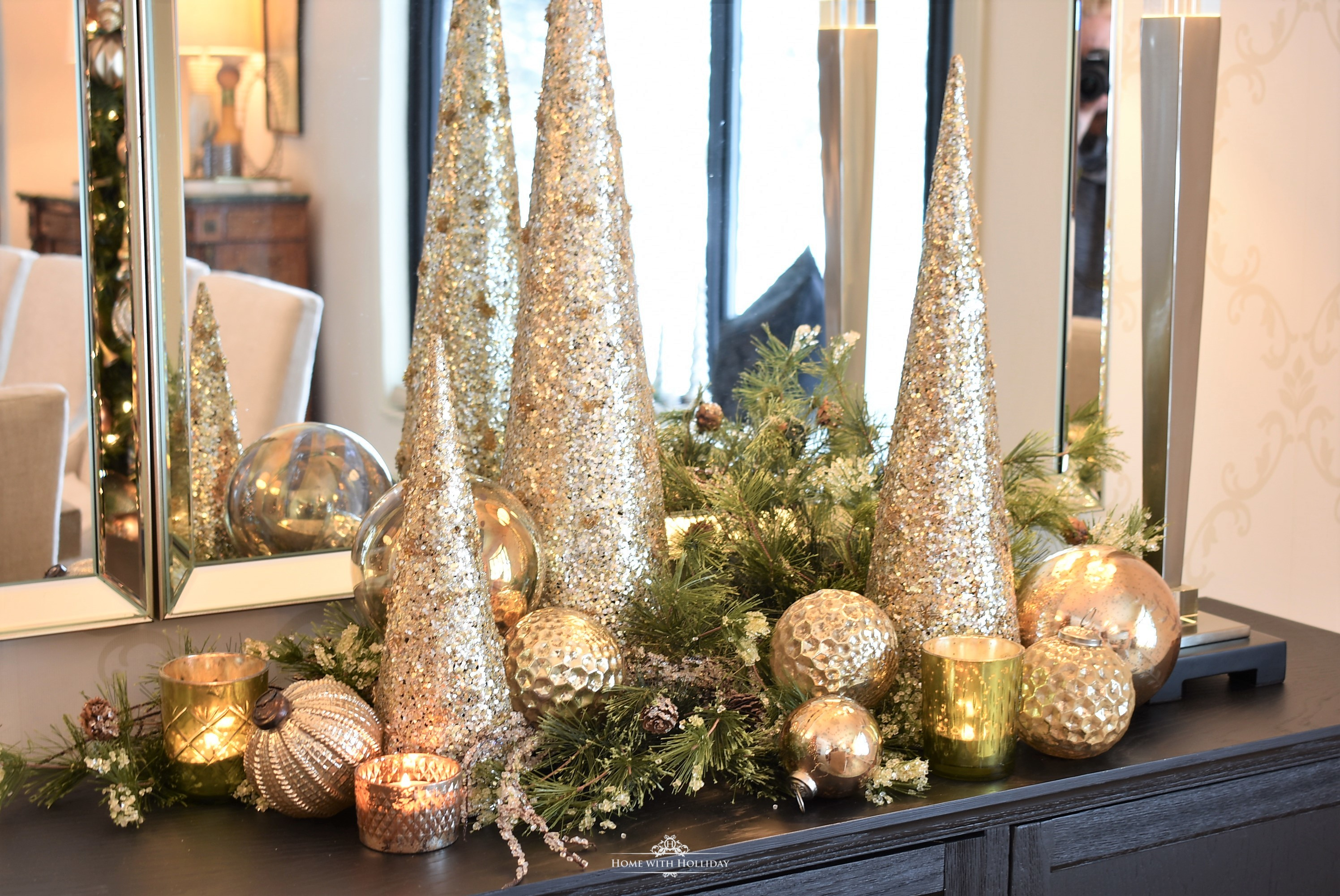 Silver and Gold Glam Christmas Centerpiece with gold cone trees and a black buffet