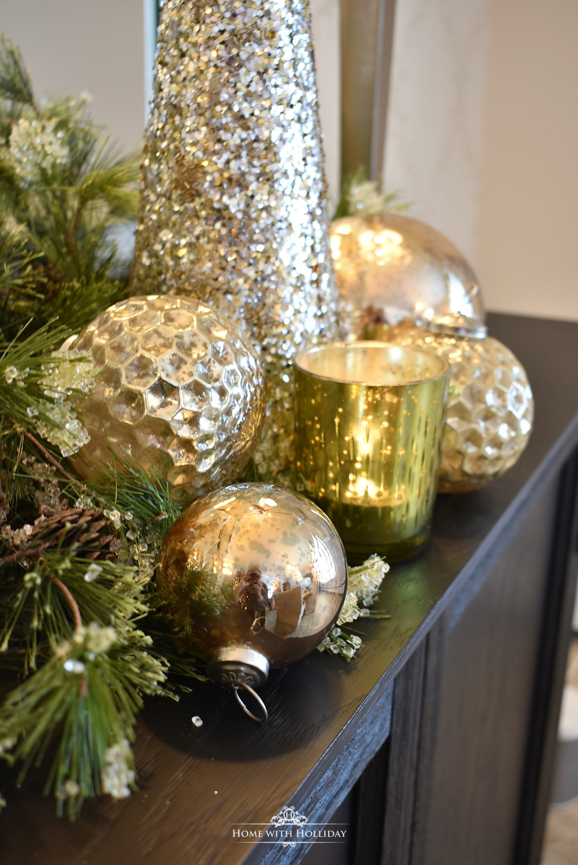 Silver and Gold Glam Christmas Vignette with gold ornament balls and greenery