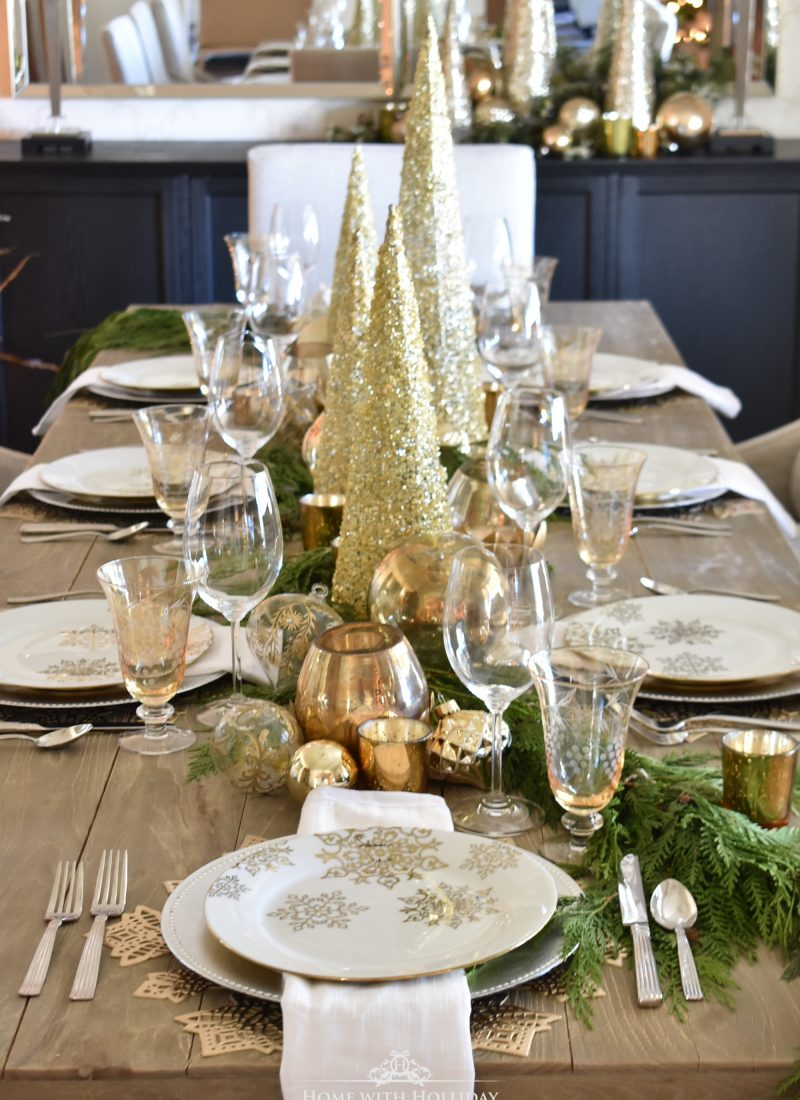 A Snowflake Christmas Tablescape with Gold Christmas Cone Trees in the centerpiece