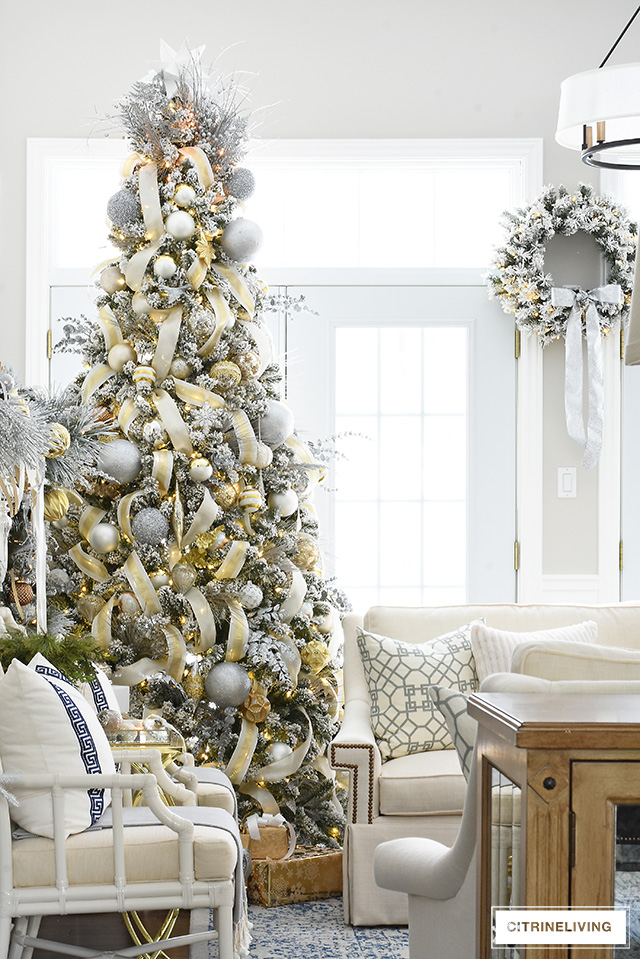 https://citrineliving.com/flocked-christmas-tree-garland-silver-gold/
