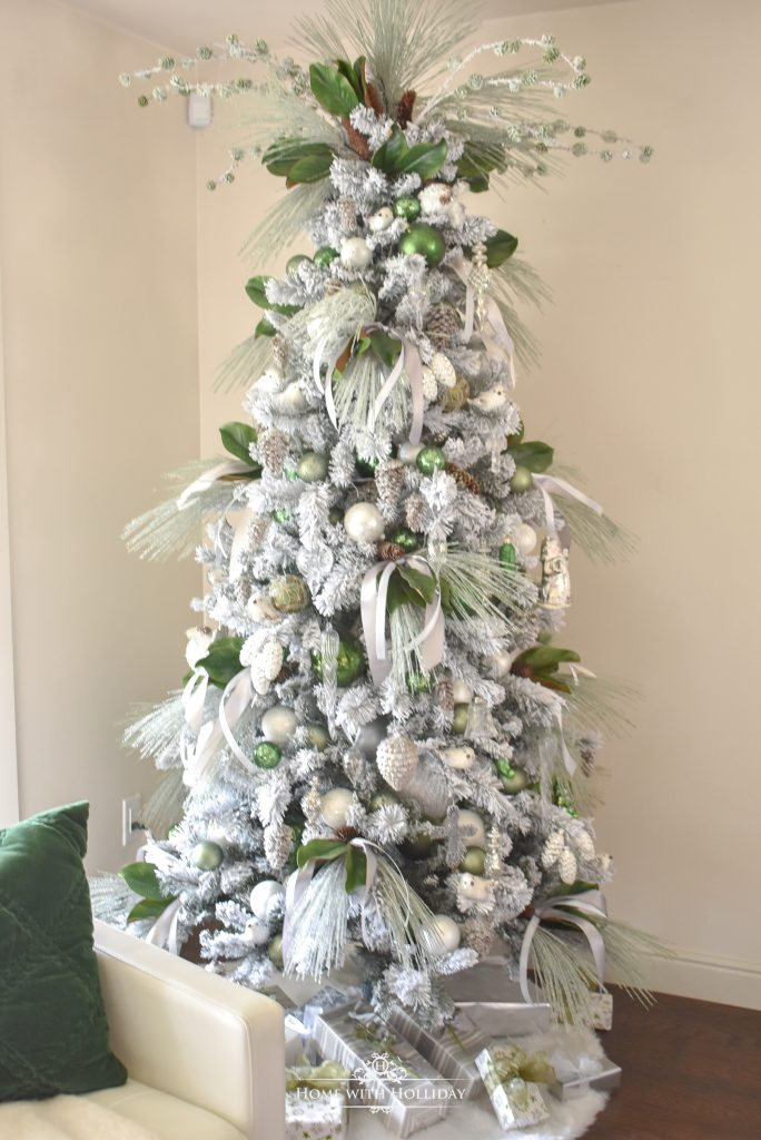 A Flocked Green and White Pine Cone Themed Christmas Tree - Home with Holliday
