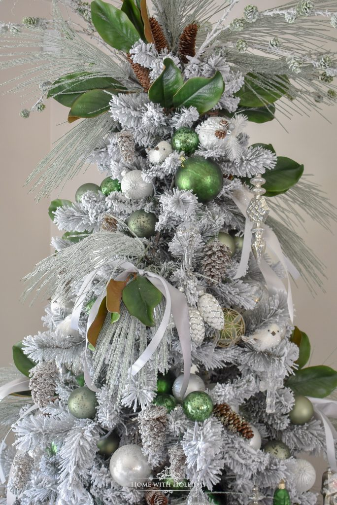 A Flocked Green and White Pine Cone Themed Christmas Tree