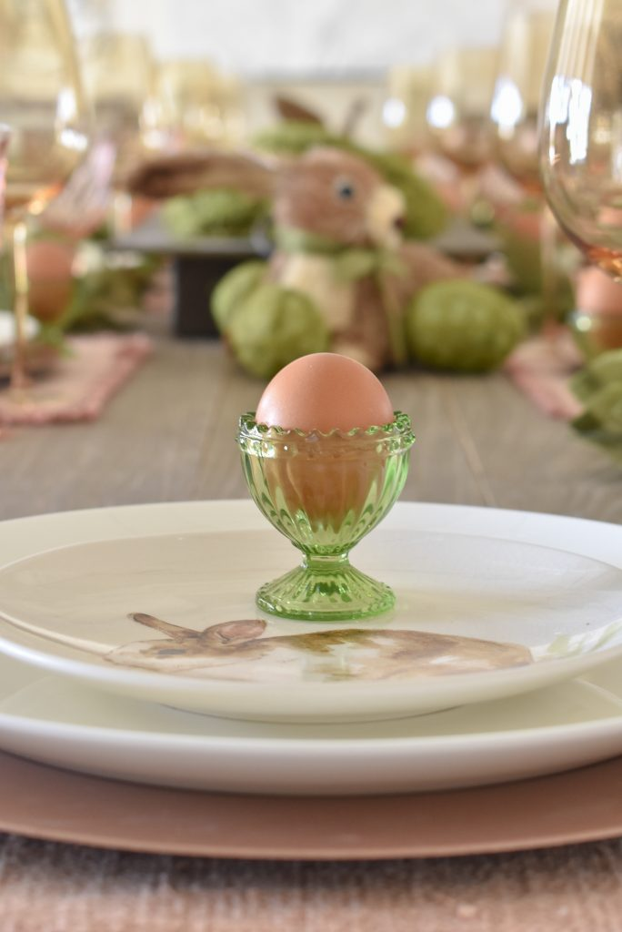 Easter Egg on top of a salad plate for an Easter Table Setting