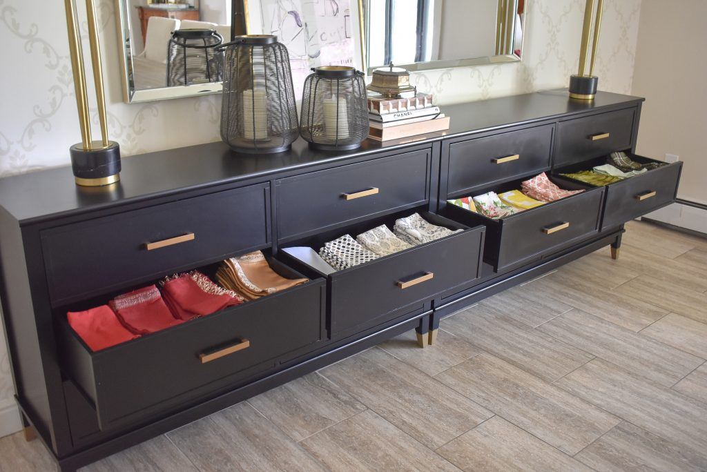 Black sideboards for storing napkins.