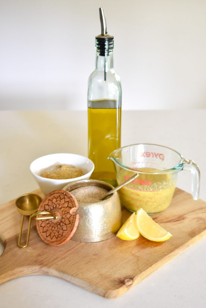 Ingredients for a Lemon Vinaigrette Dressing - Olive oil, lemon, dijon mustard and a house seasoning