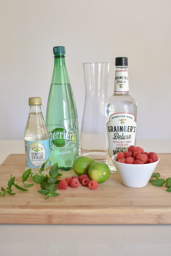 Ingredients for a Raspberry Vodka Spritzer with Mint and Lime