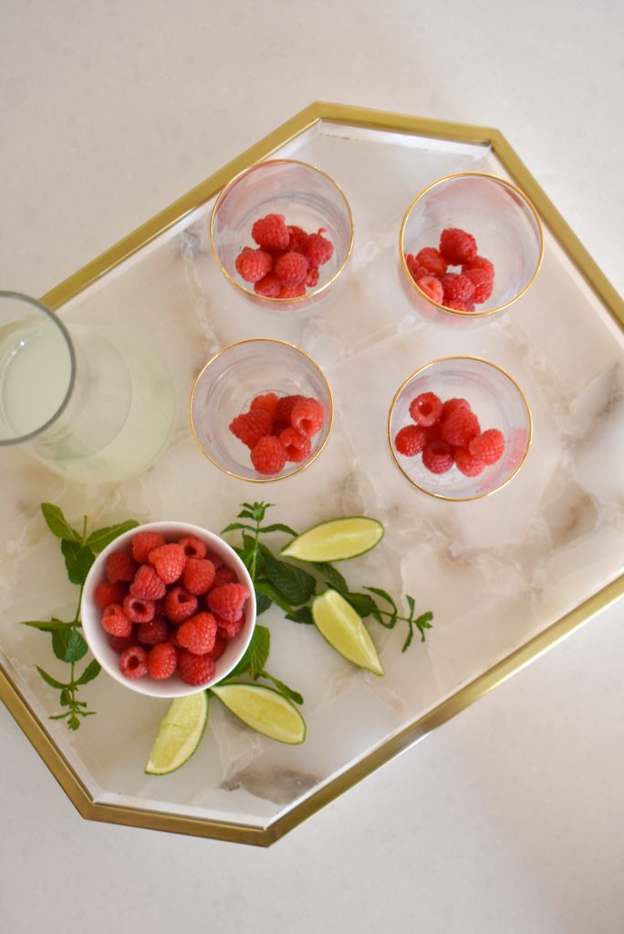 Fresh Raspberries in Cocktail Glasses for a Raspberry Vodka Spritzer with Mint