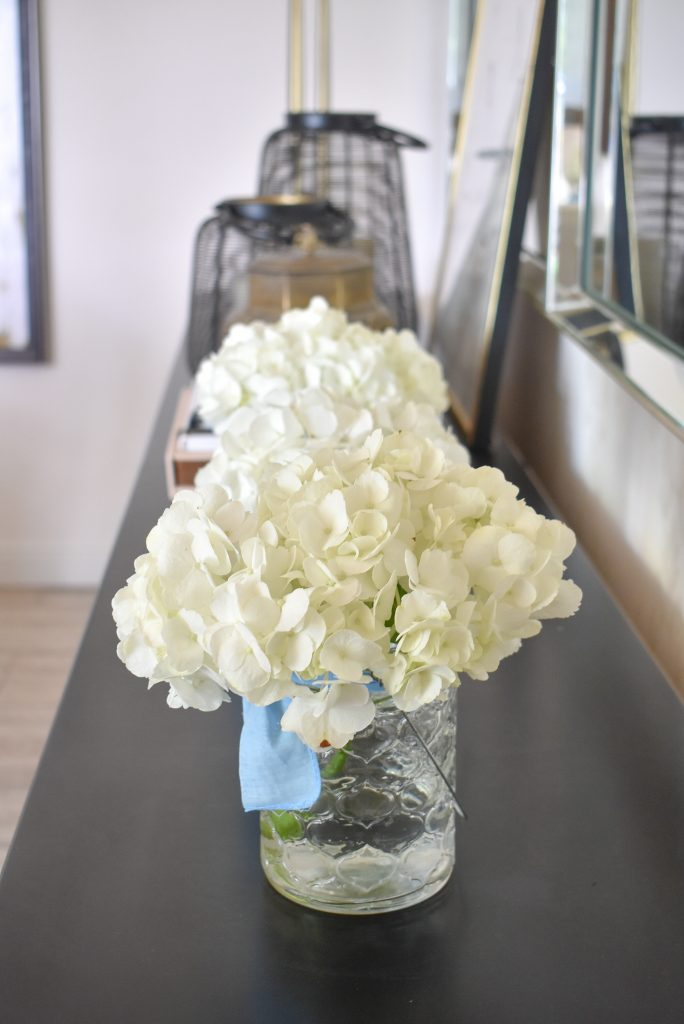 White Hydrangea arrangements on a dining room buffet