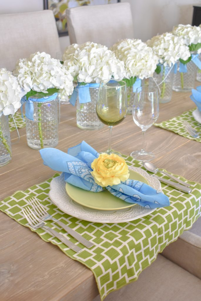 Green, blue, and yellow place setting on a Simple and Bright Summer Tablescape
