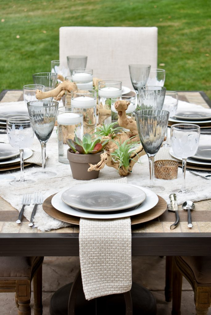 Centerpiece on a Neutral Fall Alfresco Dining Tablescape with neutral colors and succulents