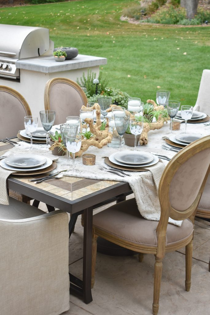 A Neutral Fall Alfresco Dining Tablescape with neutral colors and succulents