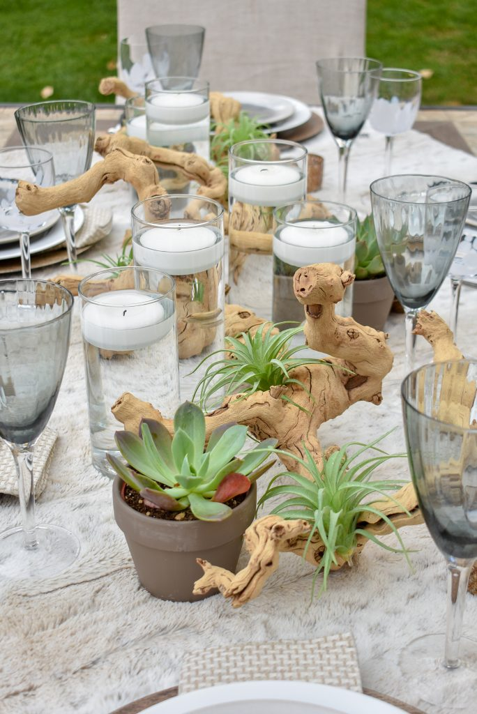 Grapewood Centerpiece on a Neutral Fall Alfresco Dining Tablescape with neutral colors and succulents