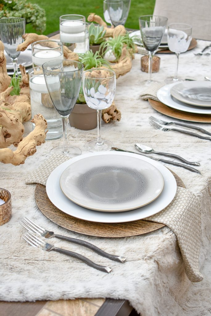 A Neutral Fall Alfresco Dining Tablescape with a throw blanket