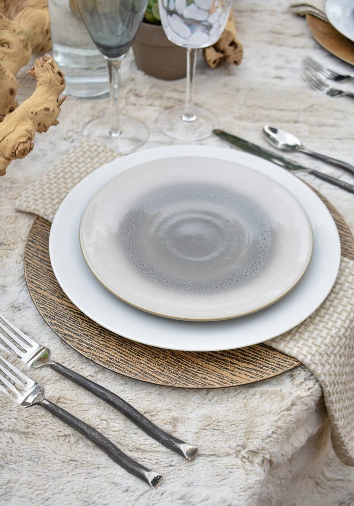 Place Setting on a Neutral Fall Alfresco Dining Tablescape with neutral colors on a throw
