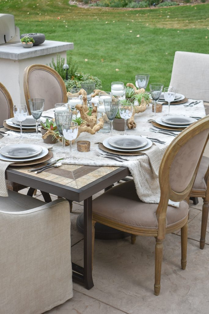 An Outdoor Neutral Fall Alfresco Dining Tablescape with succulents