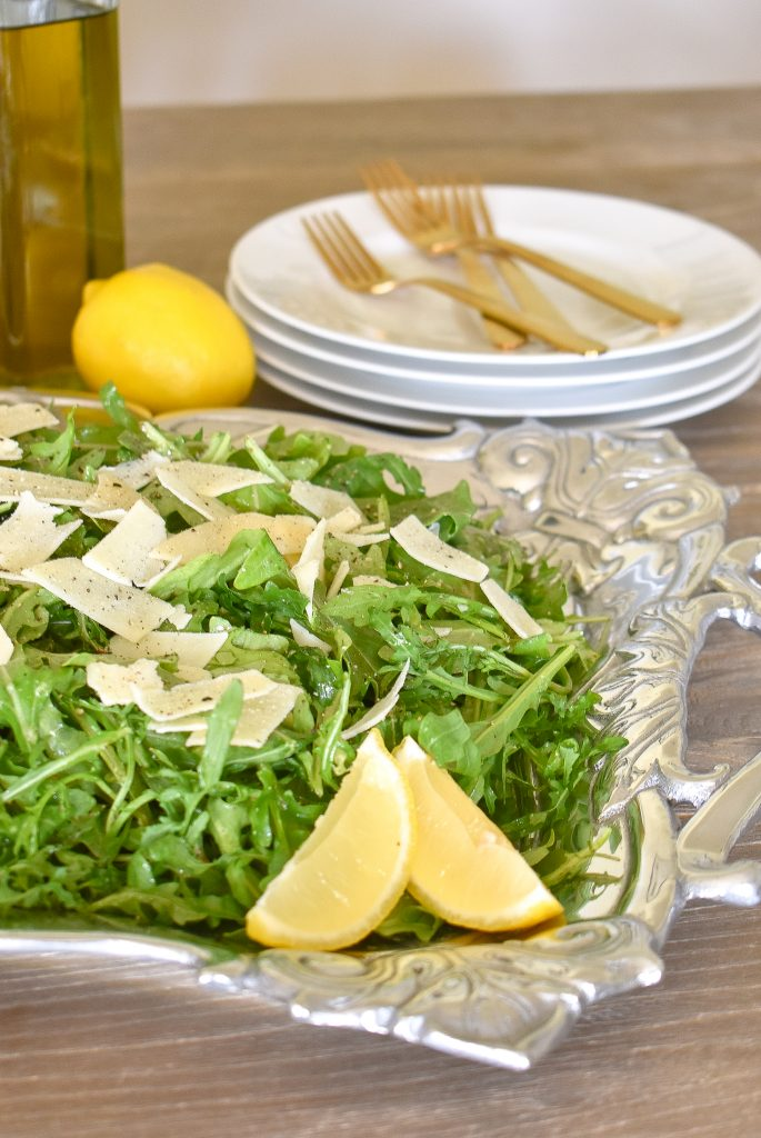 Arugula Salad with Lemon Vinaigrette Dressing on a beautiful tray