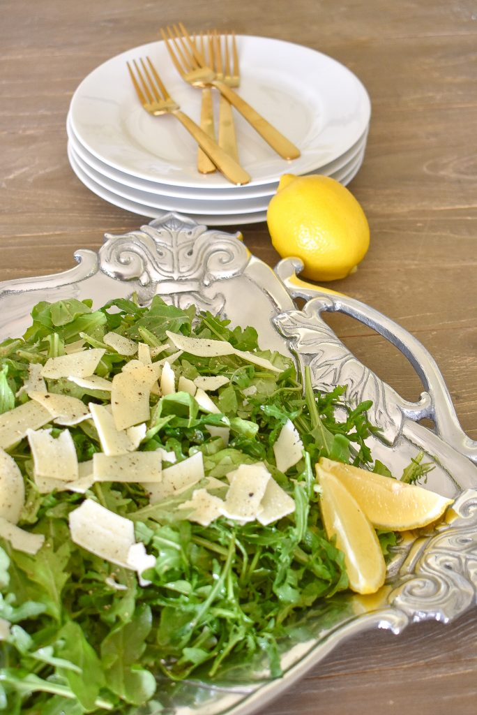 Arugula Salad with Lemon Vinaigrette Dressing on a Tray