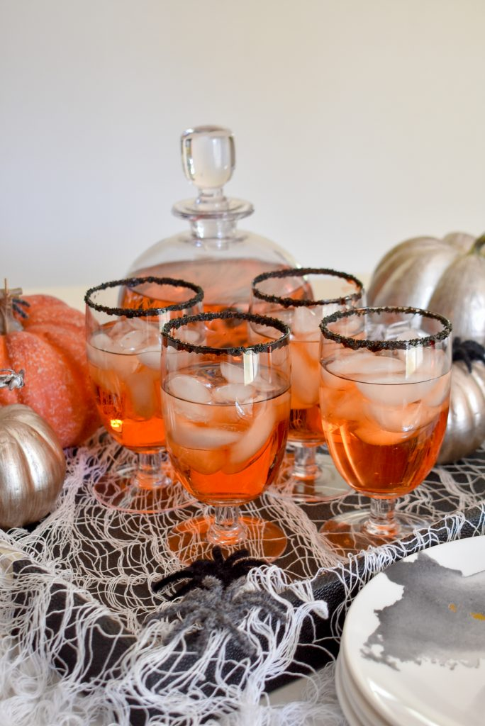 Blood Orange and Vodka Cocktail on a tray decorated for Halloween