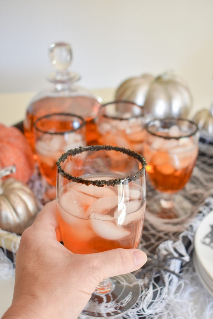 Blood Orange and Vodka Cocktail in a smoke beverage glass with black sanding sugar