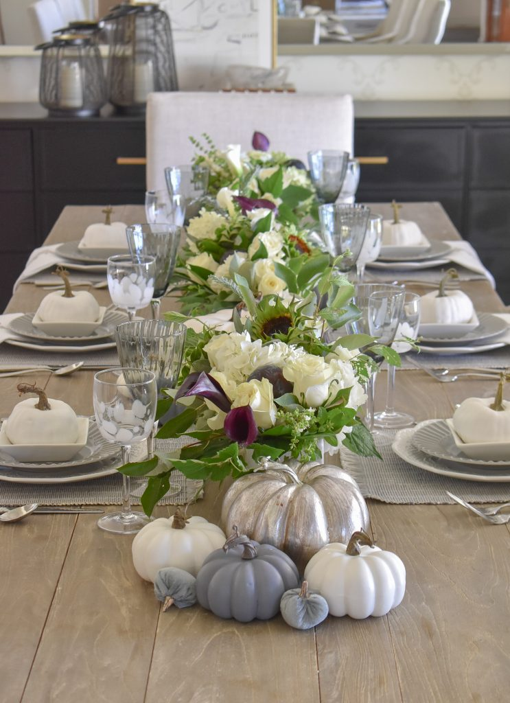 A fall tablescape with shades of greys and whites