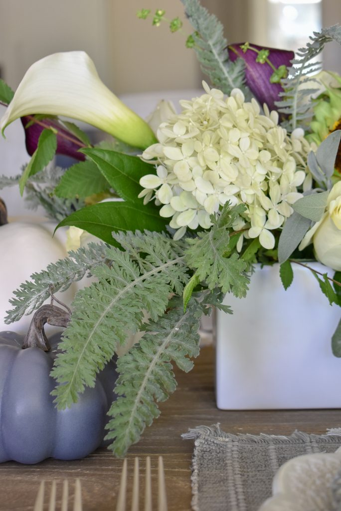 Flowers on a Fifty Shades of Grey and White Fall Tablescape
