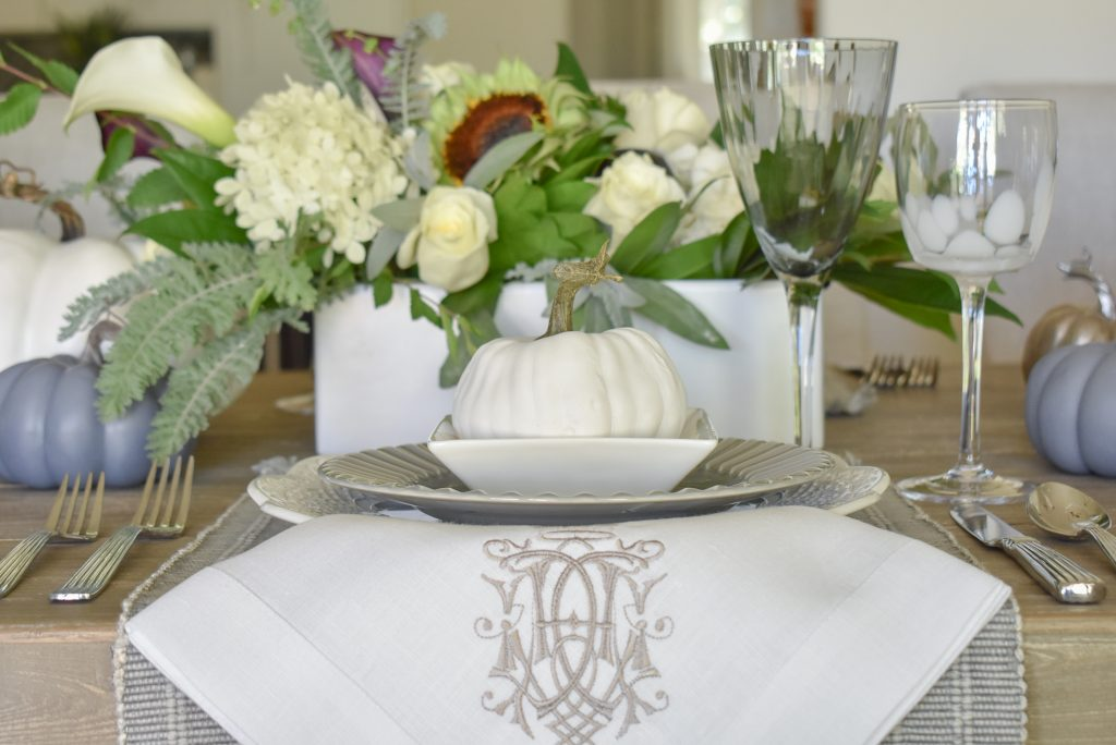 White Pumpkin on top of a place setting on a Fifty Shades of Grey and White Fall Tablescape