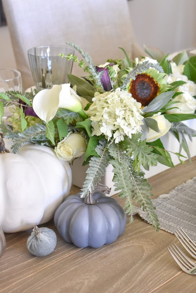 Centerpiece with pumpkins on a Fifty Shades of Grey and White Fall Tablescape