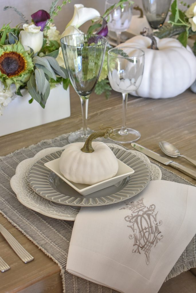 Place settings on a Fifty Shades of Grey and White Fall Tablescape
