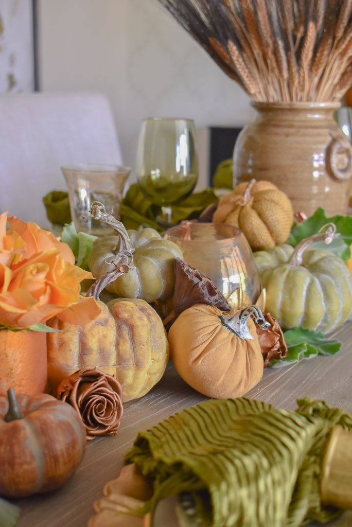 Olive Green and Gold Fall Tablescape Centerpiece with piles of pumpkins