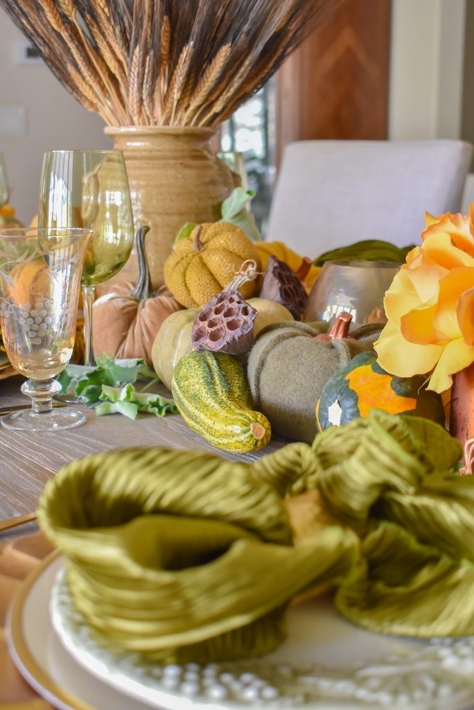 An Olive Green and Gold Fall Tablescape with Pumpkins and Gourds