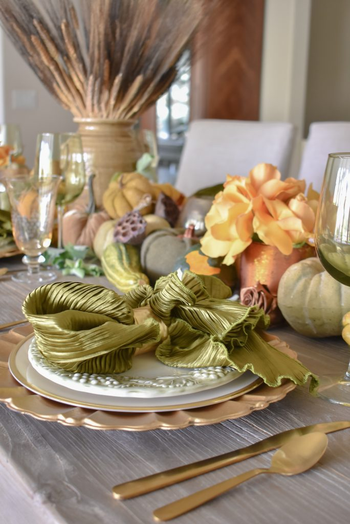 Olive Green and Gold Fall Tablescape Place Setting with ruffled olive green napkin