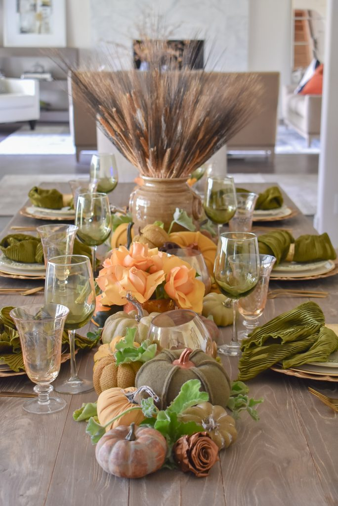 An Olive Green and Gold Fall Tablescape with pumpkins and roses