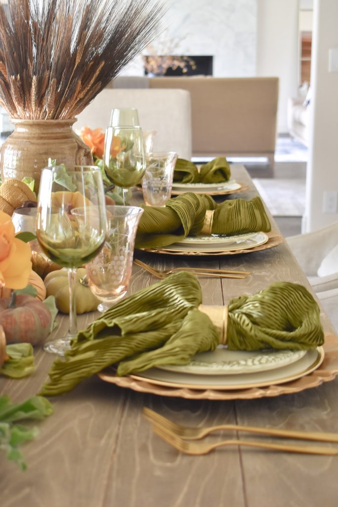 Olive Green and Gold Fall Tablescape Place Settings with gold and olive green napkins