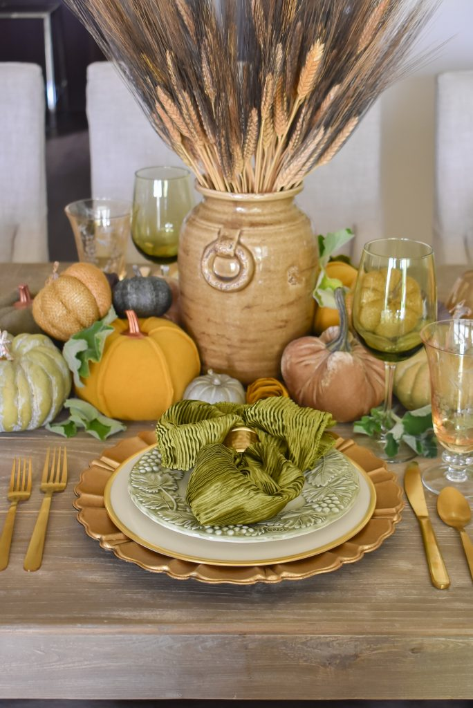 An Olive Green and Gold Fall Tablescape with Pumpkins