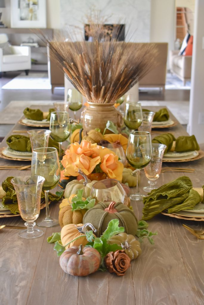 Olive Green and Gold Fall Tablescape with a lot of Pumpkins