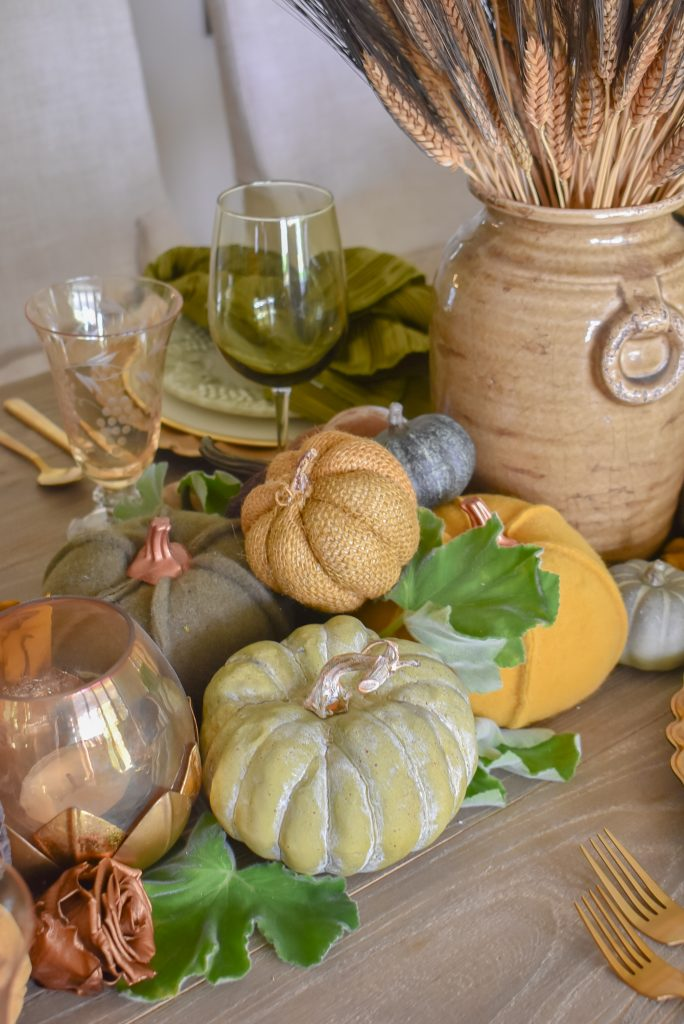 Olive Green and Gold Fall Tablescape with Pumpkins piled together