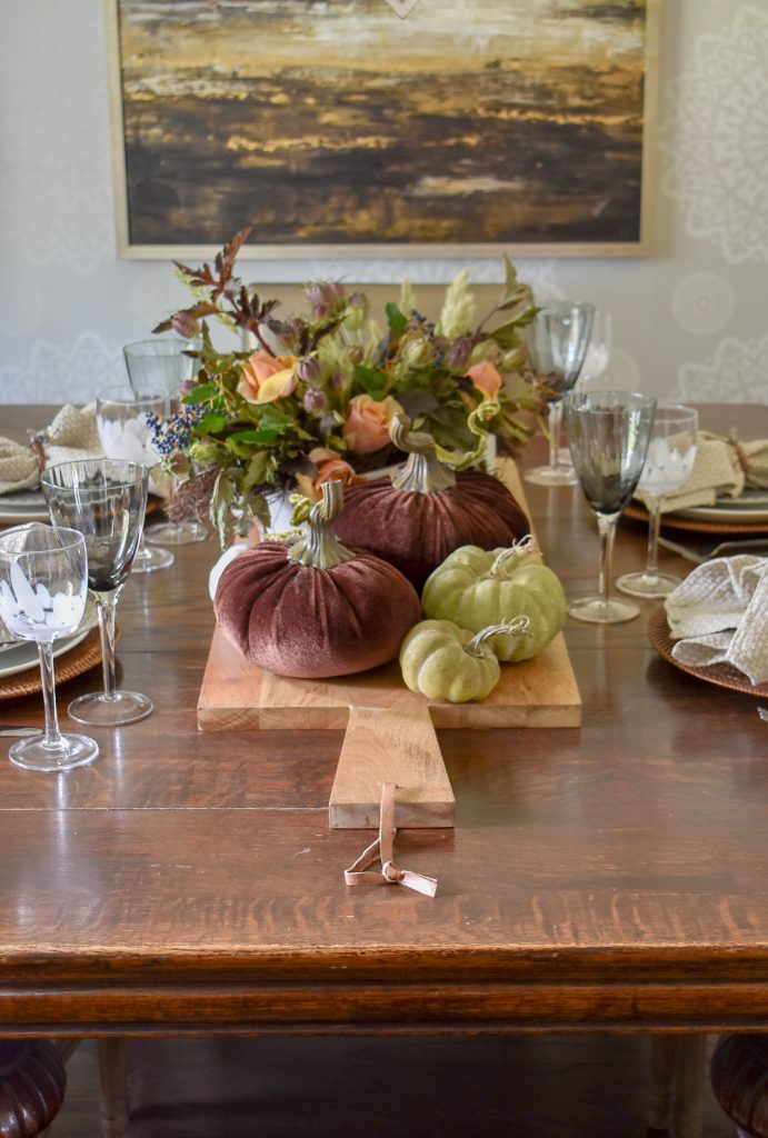 A Rustic Fall Tablescape with Pumpkins on a wood tray