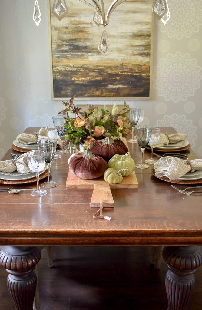 A Rustic Fall Tablescape with Pumpkins on an antique table