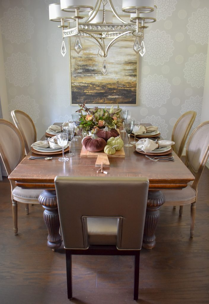 A breakfast room with Rustic Fall Tablescape with Pumpkins