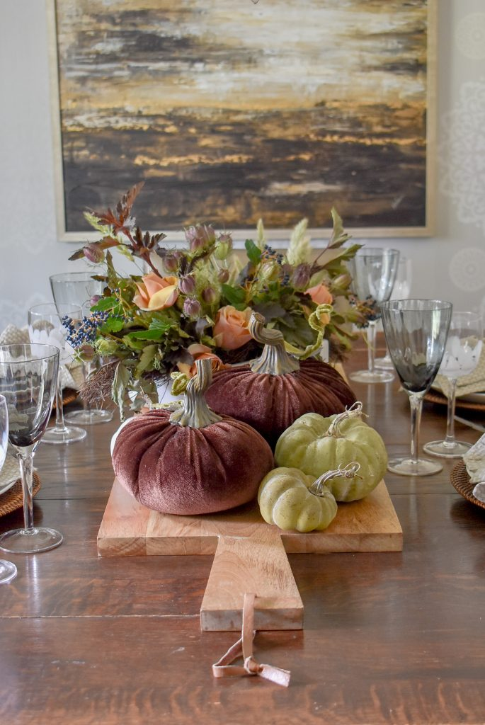 The Centerpiece on a Rustic Fall Tablescape with Pumpkins