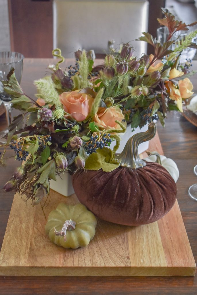 A centerpiece on a Rustic Fall Tablescape with Pumpkins on a tray