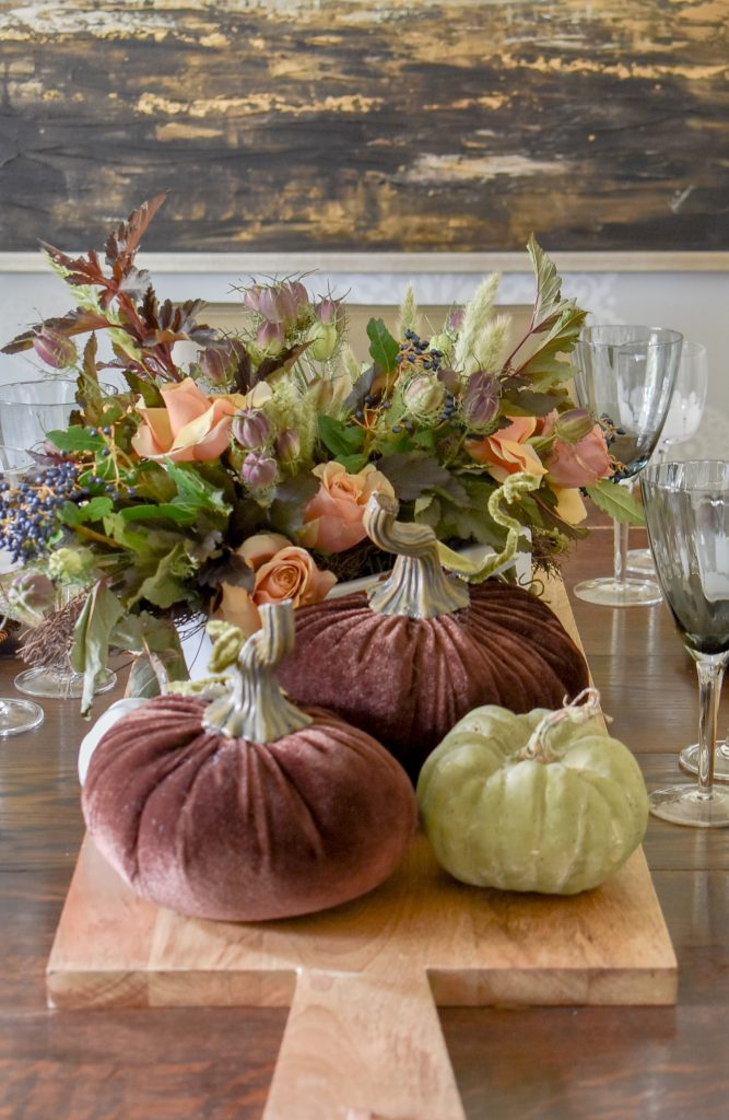 A centerpiece on a Rustic Fall Tablescape with Pumpkins