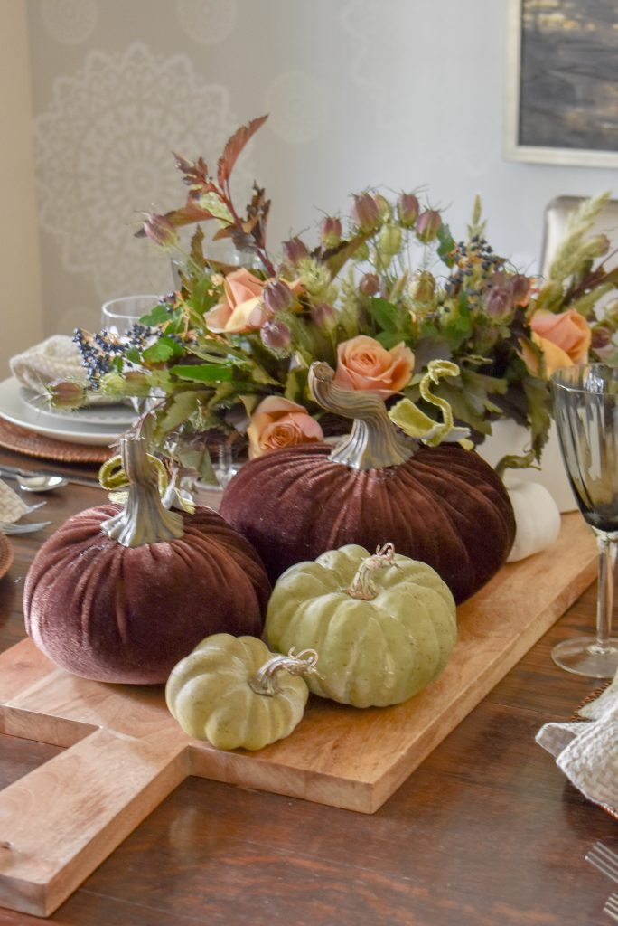 A Rustic Fall Tablescape with Green and Brown Pumpkins on a tray