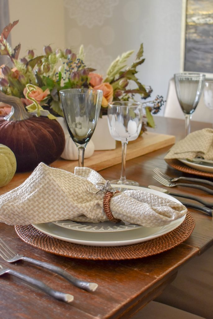 Neutral Place Settings on a Rustic Fall Tablescape with Pumpkins