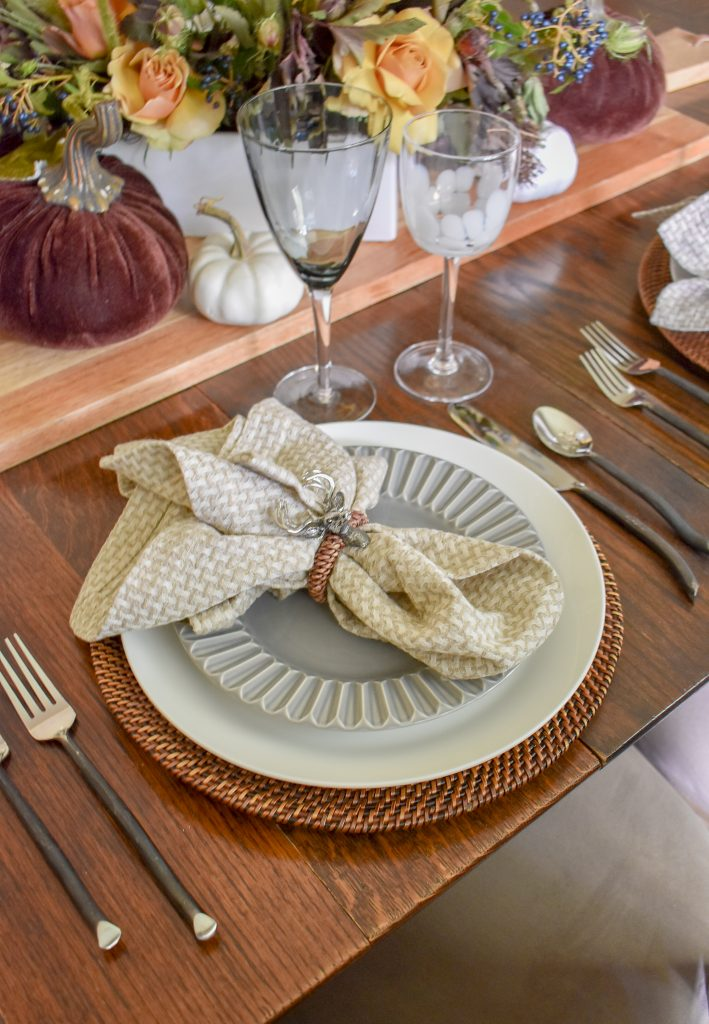 Neutral Place Setting on a Rustic Fall Tablescape with Pumpkins