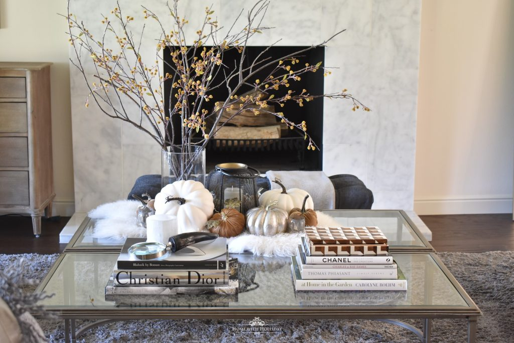 Warm and Cozy Coffee Table Styling for Fall with pumpkins