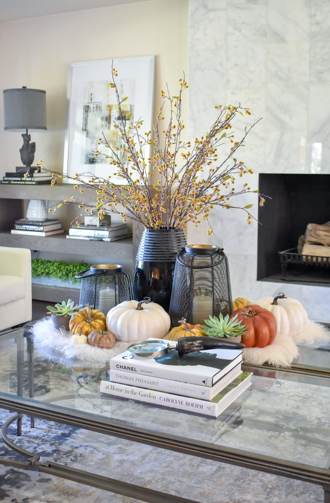 Warm and Cozy Coffee Table Styling for fall with black accents and fall branches