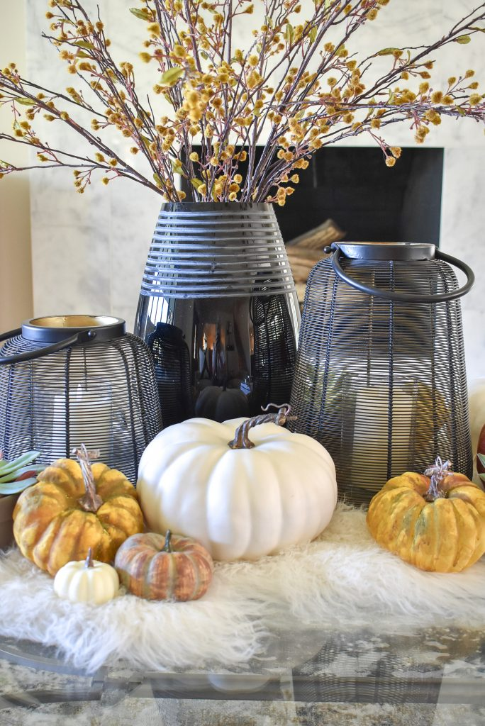Warm and Cozy Coffee Table Styling for Fall with black accents on a faux fur throw