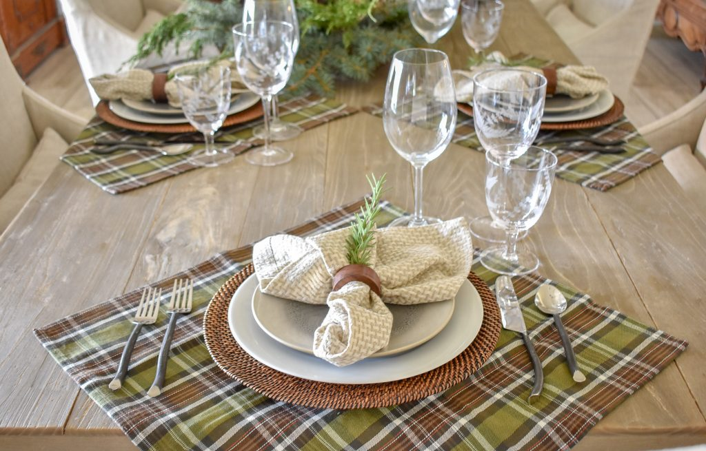 A place setting on a Casual Evergreen Thanksgiving Table Setting with plaid