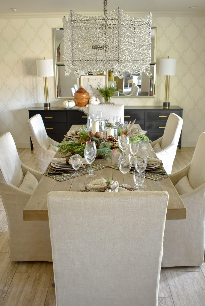 A Casual Evergreen Thanksgiving Table Setting with plaid